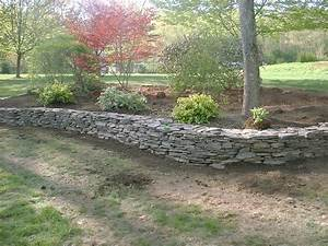 Natural rock retaining wall and flower beds salem nh for Flower bed wall