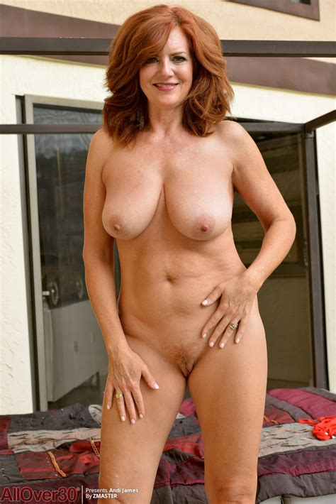 Mature Redhead Andi James Cups Her Natural Tits While