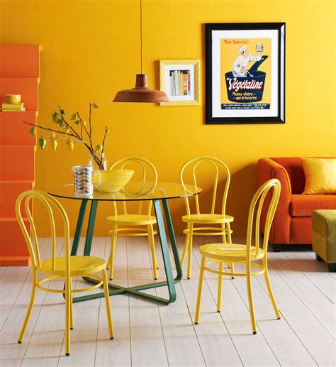 This type of product is a high quality coffee table that has got a durable wooden base with carved decorative original cottage coffee table displaying unpretentious, simple design and sunny, light finish, this coffee table beams with joyful cottage style. Cozy Simple Dining Room Design Using Light Yellow Wall Color With Round Glass Table And Pendant Lamp