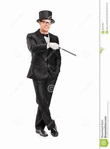 Magician Holding A Magic Wand Posing Royalty Free Stock ...