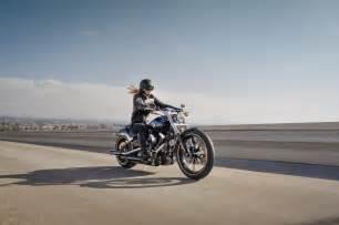 Woman On Harley-Davidson Motorcycle
