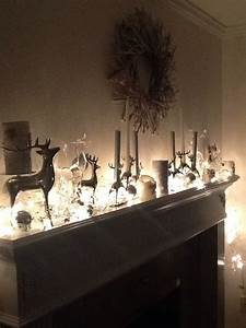 silver, and, white, mantle, with, white, lighted, garland