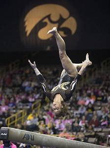 University of Iowa's Sydney Hoerr competes on the beam ...