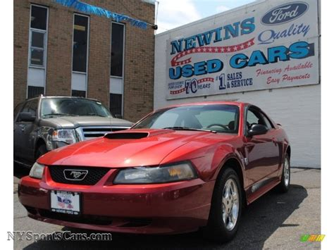 Newins Ford by 2004 Ford Mustang V6 Coupe In Redfire Metallic Photo 14