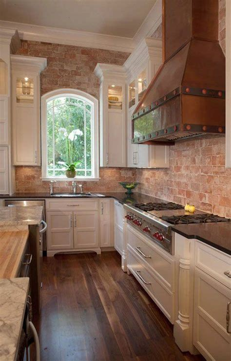 brick backsplash in kitchen kitchen with brick walls home pinterest countertops hoods and exposed brick