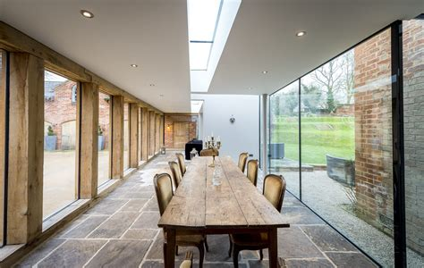 contemporary oak glass extension  listed house leaf architecture
