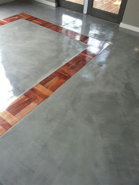 Upcycled refurbished parquet tiles together with Cemcrete