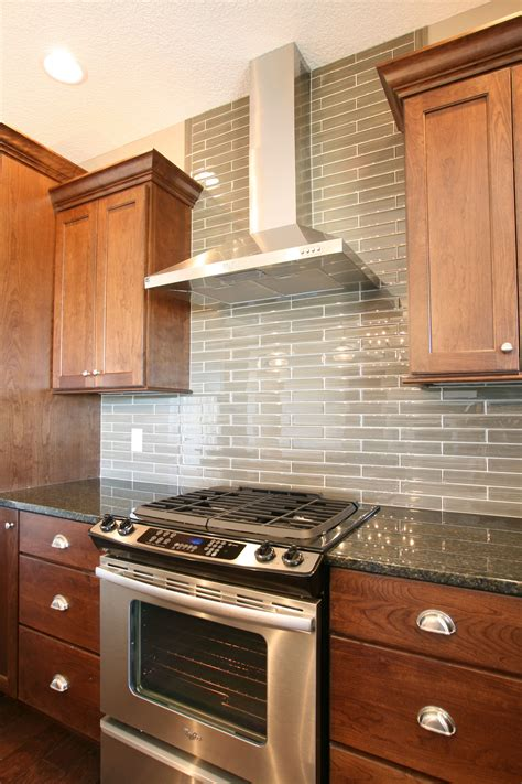kitchen stove backsplash glasstile extends all the way to the ceiling this