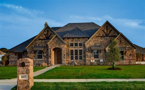 custom home designers bailee custom homes rustic exterior dallas by q