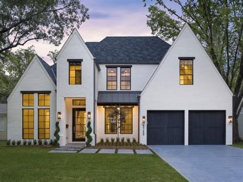 Modern Tudor  White With Black Windows, Partial Metal