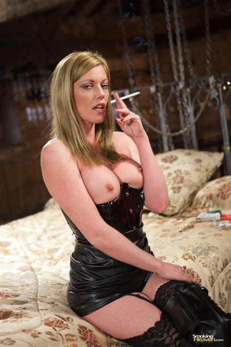 Mistress Holly Kiss Smoking A Cigarette On Her Bed 1 Of 1