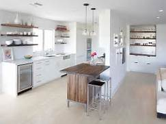 Dealing With Built In Kitchens For Small Spaces Let The Small Island Bring Textural Contrast To The Space Design