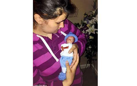mother held   week  premature baby   hour