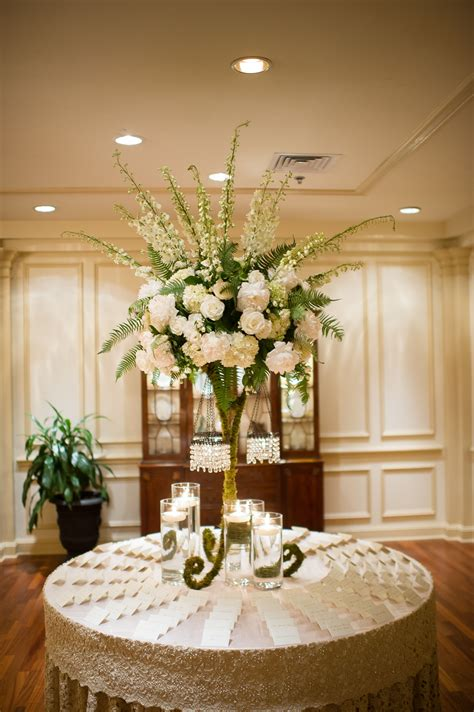 tall flower arrangement with ivory roses and delphiniums