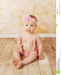 Baby girl wearing pearls stock photo. Image of baby ...