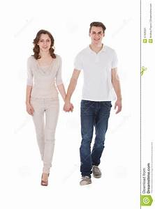 Couple In Casuals Walking Over White Background Stock ...