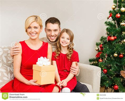 smiling family holding gift box royalty free stock image