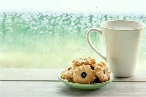 Coffee cup and cookies biscuits on white background spinning around seamless loop 3d. Cookie And Coffee Cup On Rainy Day Window Background Stock Image - Image of pile, cold: 60189159