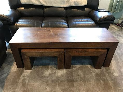 This suri nest of coffee tables has a rustic aesthetic that's perfect for modern living. Mango Wood Coffee table set (nest of tables)   in Lambourn, Berkshire   Gumtree