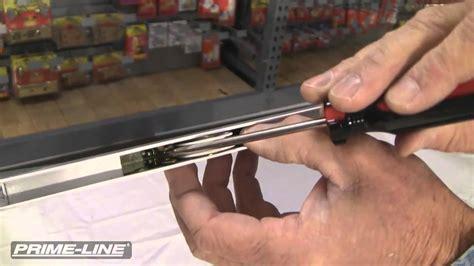 replacing a sliding screen door roller