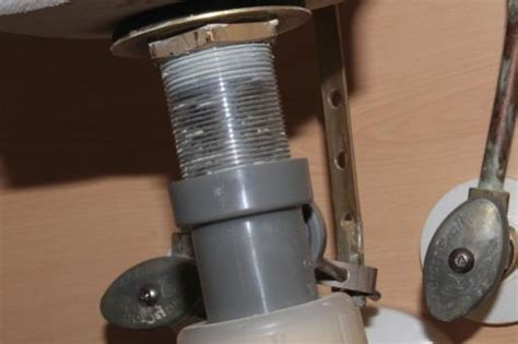 bathroom sink drain flange repair