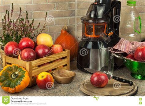 kitchen apples processing preparing autumnal juicer juices juicing juice fruit fresh apple healthy diet