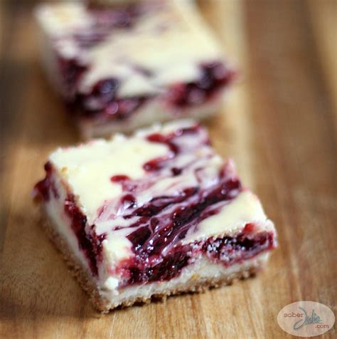 Find rich and delicious raspberry cheesecake recipes using both fresh raspberries and frozen so you can enjoy a slice year round! EASY Raspberry Swirl Cheesecake Bars Recipe - Sober Julie