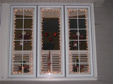 how to hang christmas lights around windows 20 christmas window decorations ideas for this year