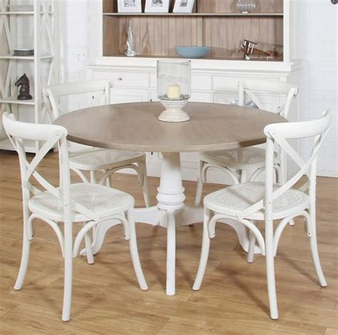 mango wood dining table and white painted chairs