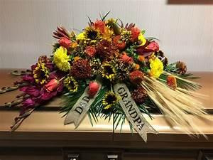casket funeral flowers