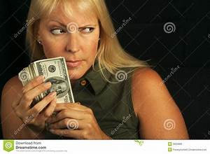 Woman Holding Stack Of Money Stock Photos - Image: 3025883