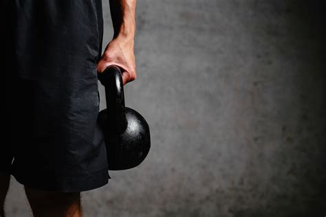 kettlebell exercises workout arm crossfit workouts build holding muscle exercise askmen kettlebells carry fitness houden gespierde een muscular runners depositphotos