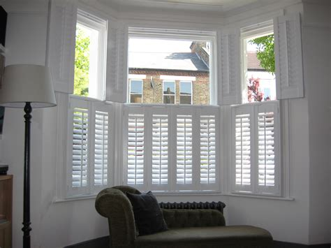 the blinds and shutters for a bay window