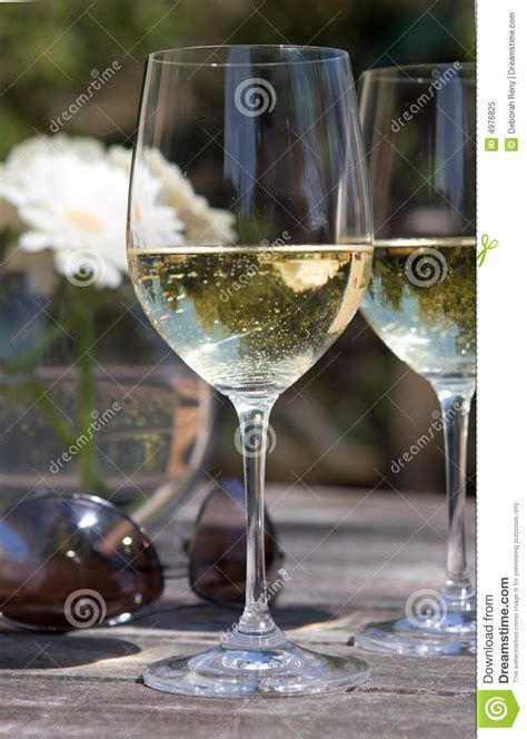 white wine glass  patio table aviators flower royalty