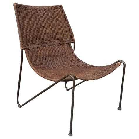 woven rattan and wrought iron slipper lounge chair for