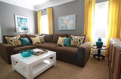 brown, gray, teal and yellow living room with sectional