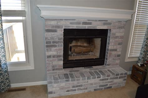 whitewash brick fireplace how to whitewash brick our fireplace makeover loving here