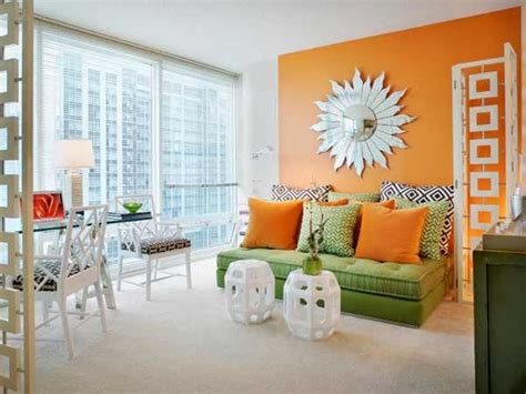 living room with orange walls casual modern living room designs with colorful decor