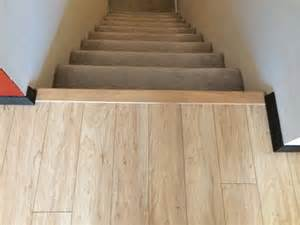 handy in ks installing pergo laminate flooring transitions stair nose and baseboards