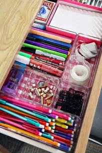 line your desk drawers with scrapbook paper and add clear