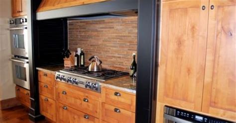 kitchen cabinets and counter tops knotty alder with painted black distressed accents www 7988