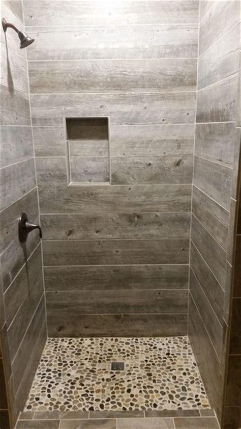rustic bathtub tile surround barnwood tile shower with pebble base rustic bathroom