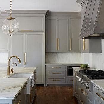 white shaker kitchen cabinets  brushed brass knobs