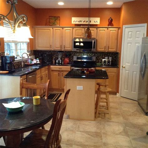 burnt orange kitchen cabinets burnt orange kitchen with new tile flooring hus 4998