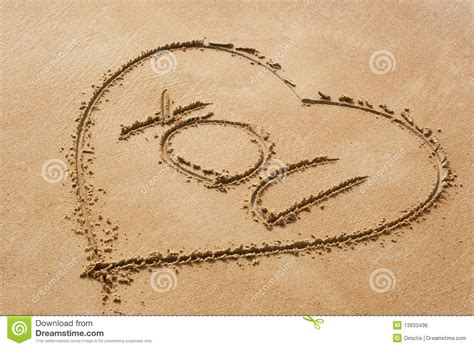 Heart Shape Symbol With The Word You On Sandy Beac Stock