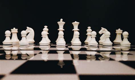white chess game set photo  chess image  unsplash