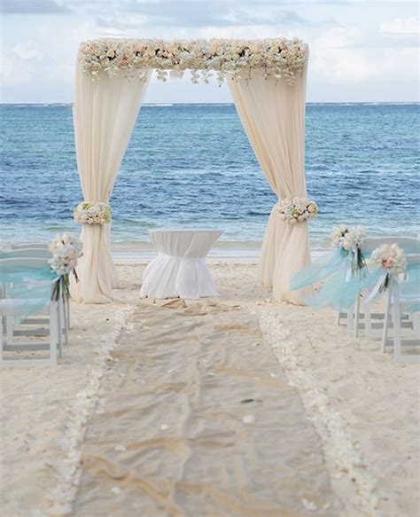 elegant caribbean beach wedding arch by weddings