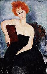 Young redhead in an evening dress