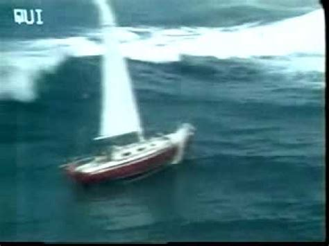 Small Boat Large Waves by Sailboat Gets Hit By Wave