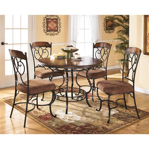 ashley furniture dining tables and chairs signature design by ashley nola 5 piece round dining table